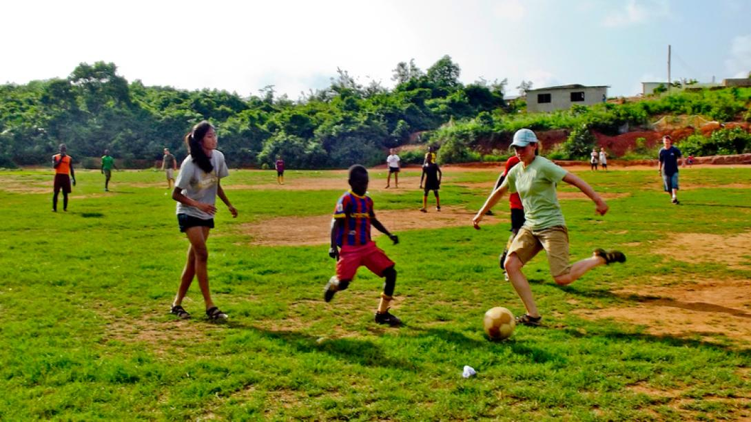 Football coaches play a game with their students in Ghana.